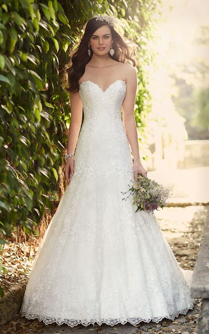 Embrace romantic details with this classic lace A-line bridal gown from the Essense of Australia wedding dress collection. It features a gorgeous sweetheart neckline, scalloped lace hem, and a classic chapel train.