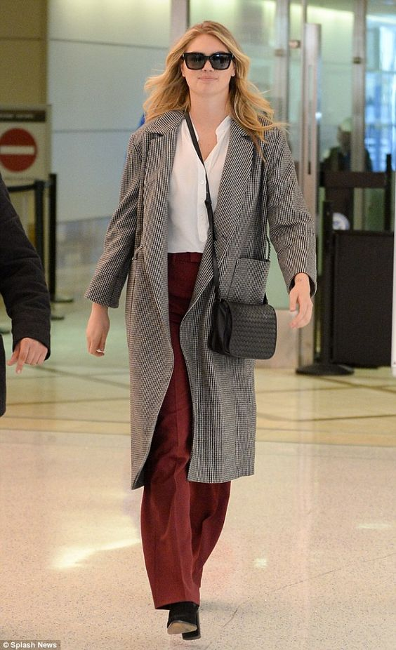Business best! Kate Upton was covered up for a flight into Los Angeles on Monday, sporting...
