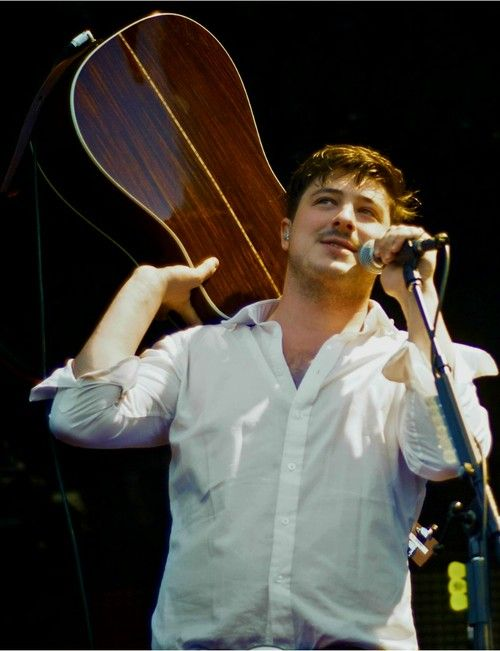 Marcus Mumford, the masculinity in which he throws his guitar around...I WILL be front row this time. Sept. 10th!!!