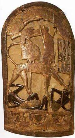 King Tutankhamun Exhibit--The only item of true body armor recovered from the tomb was a close-fitting leather cuirass, found in a crumpled up state in box 587 in the Annex. It is described by Carter as 'made up of scales of thick tinted leather worked onto a linen basis, or lining, in the form of a ...bodice without sleeves'.: