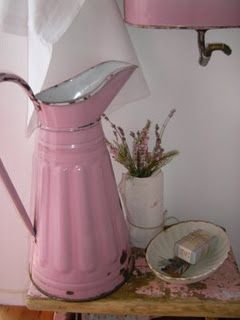 A pink french enamelware pitcher - I love that it shows the marks of time.