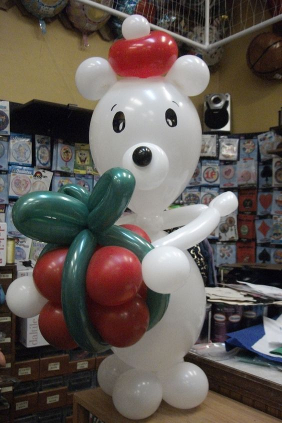 "Here is ""BB"" our balloon bear. He can be made out of any color you wish and doesn't have to have a Red hat. We just made him look like this for Christmas. Designed by Balloons by Night Moods, in Juneau, Alaska 907-523-1099 www.juneausbestballoons.com"