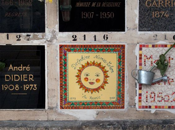 Columbaria – A Place of Peace and Personality - While many of the niches in the columbarium at Paris's Père-Lachaise Cemetery are quite traditional, some people have used their space to project their personality for eternity