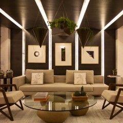 Érica Salgueiro. Com 80m², este ambiente é, em sua essência, uma releitura de cafés italianos. O destaque do ambiente é a sala com o jardim suspenso.