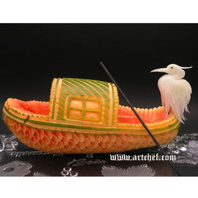 Cormorant and Fishing Boat:   Artist: Jimmy Zhang    Jimmy Zhang, a graduate of the Culinary Arts Institute in China, has always been fascinated by the ancient art of fruit and vegetable carving. He got the idea for this masterfully carved melon from a photo of a lonely boat with a cormorant standing on the bow. Want to learn Jimmy's skill? Check out his classes at Art Chef Inc. in the San Francisco Bay Area.