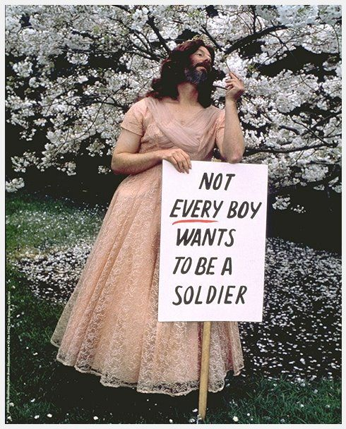 """Not every boy wants to be a soldier."" Facial hair with otherwise feminine fashion."