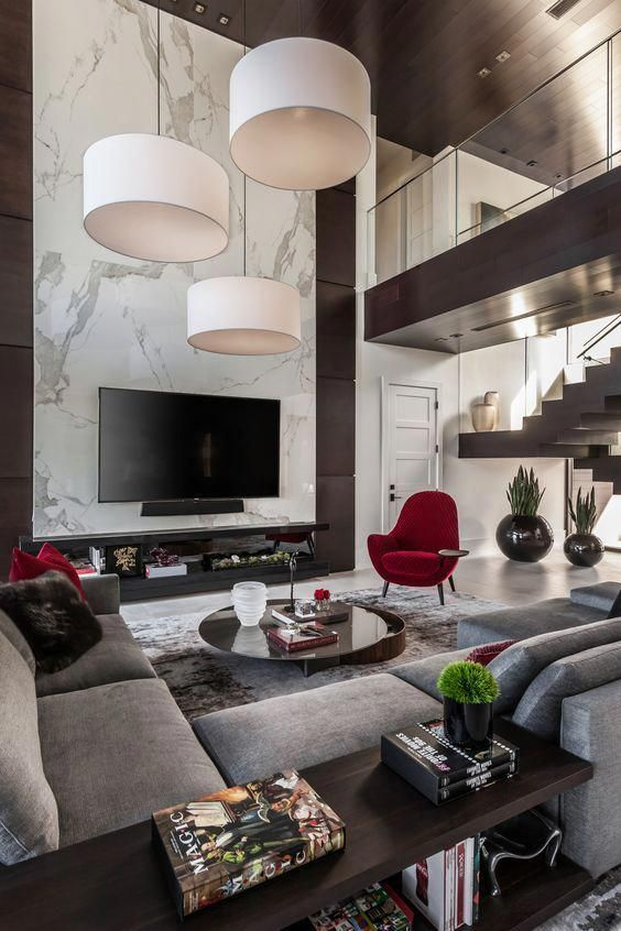 Black White Grey More Grey Red The Single Red Chair Acts As An Accent In This Room And Adds A P Luxury Living Room Home Living Room Modern Houses Interior #red #white #and #grey #living #room