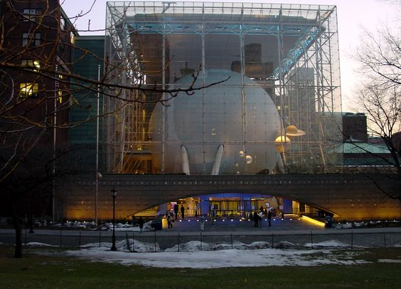 """Rose Center for Earth and Space, American Museum of Natural History, New York City. The center is housed in this great cube, seen from the 81st Street entrance. The giant sphere contains the Hayden Planetarium. (Image credit: Spheroide) Mona Evans, """"Rose Center and Hayden Planetarium"""" http://www.bellaonline.com/articles/art183413.asp"""