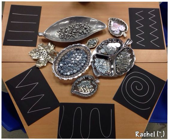 "Transient art with metal, silver & grey loose parts - from Rachel ("",):"
