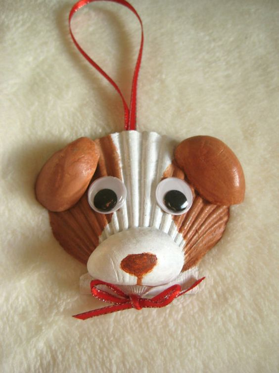 Chien avec coquille st jacques shell art pinterest - Bricolage avec coquillage ...