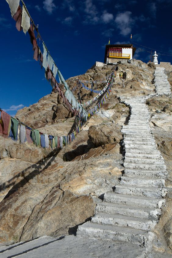 """""""There are prayer flags, lonely, ragged but enduring, high on pinnacles of rock above me; they flap in the wind, breathing everywhere the words of the Buddha."""" A.Harvey #NomadsSecrets"""