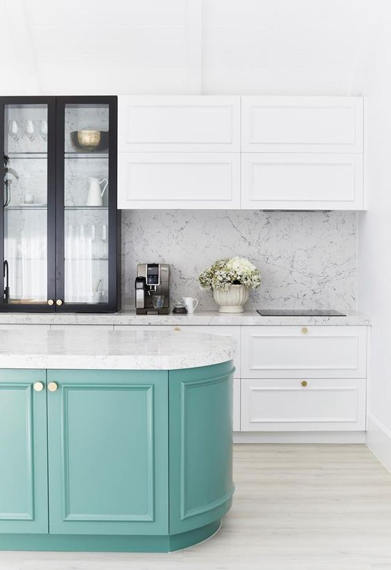 Cabinets painted in Dulux White On White provide the perfect contrast to the statement cabinetry painted in Dulux Lorna in this vibrant kitchen by Three Birds Renovations.