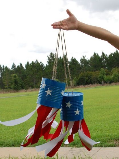 Tin Can Windsocks- Relay campsite decorations? Or kids craft as onsite fundraiser (red and white strips of fabric, blue painted tin cans and star stickers)?