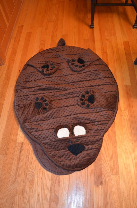 I made this bear rug for my nephews. It's a quilt as you go pattern an made out of minky fabric. They boys love their bears and they can top the toddler and twin size beds.