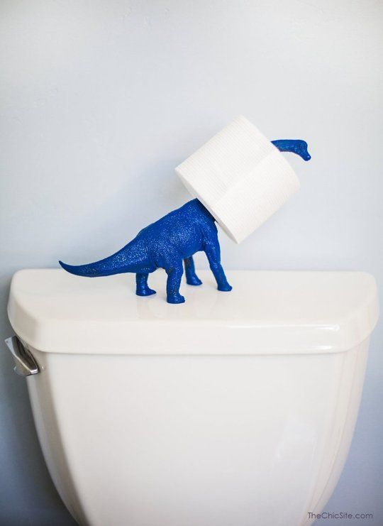 """Bold on a Budget: 10 DIY Details to Banish Boring Bathrooms. """"Nothing says 'bold' like a brightly colored dinosaur figurine generously holding your toilet paper. Spotted on The Chic Home."""" // I love this!"""