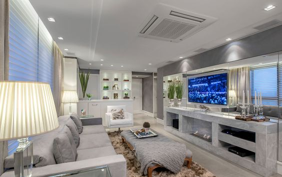 Apartamento com salas de tv e jantar integradas com a cozinha lavabo