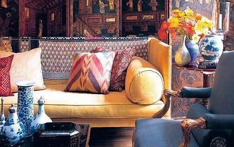 Like: mixed furniture fabric colors, vases, tapestry-inspired room divider