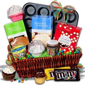 Cupcake themed gift basket, but maybe instead of a wicker basket, use an upside down lid of a cupcake travelling case with the flat base tied under.