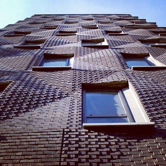by shop architects lead designer of project gary rohrbacher textured brick wall design