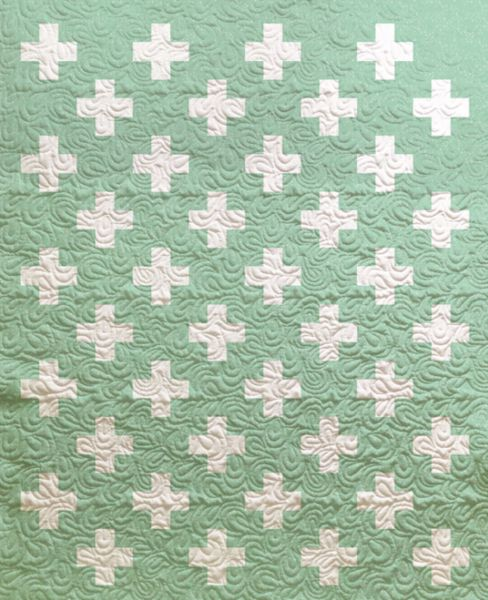 Criss cross applesauce. This quilt is perfect for picnics or to cuddle up with inside. We love the simple design that lets the colorful fabrics pop. A great nursery or toddler bedroom quilt. Your chil