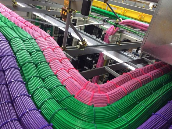 Running serious data cabling through a network center. Beautiful bundles of cables.: