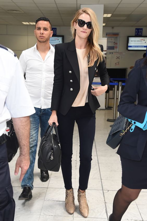 Rosie Huntington-Whiteley looks oh-so-cool in snakeskin booties at Nice Airport in France. via @stylelist | http://aol.it/YpYtqr