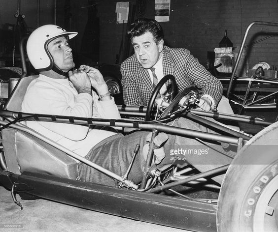 Actor James Garner, star of the television show 'Maverick', pictured at the wheel of a racing car getting tips from racing driver Jim Russell, at Snetterton drivers school, Norfolk, England, April 14th 1966.