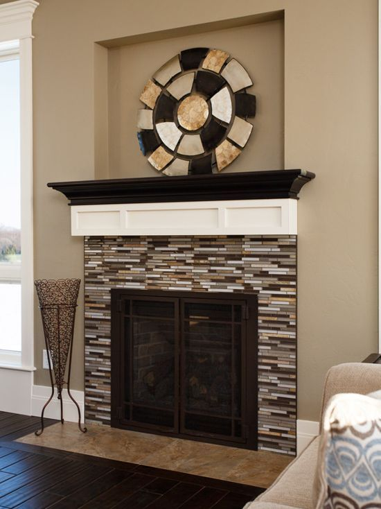 The Dark Hardwood In Front Of This Beautifully Pieced Together Fireplace Is A Perfect Combination For Fireplace Surrounds Mosaic Tile Fireplace Fireplace Tile