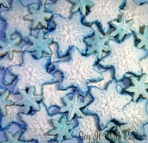 Snowflake Christmas winter cookies.  Airbrush and hand decorated shortbread cookies.
