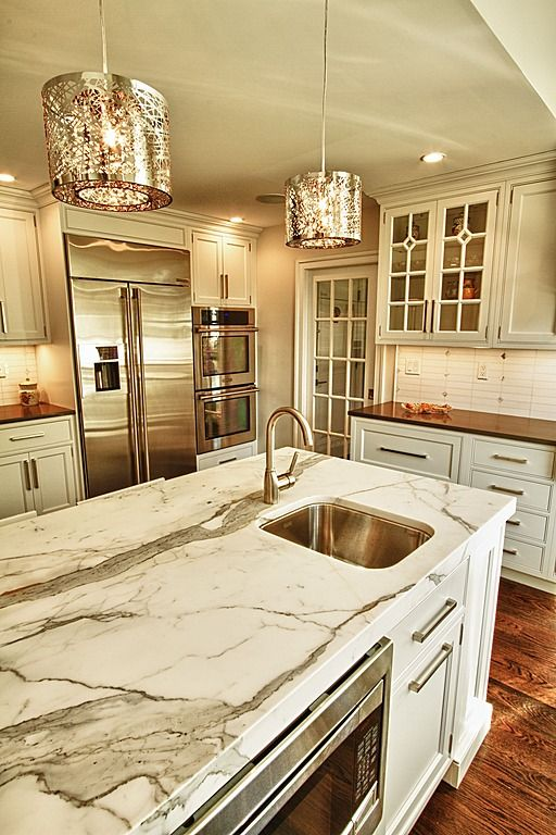The marble here has darker tones and a whole lot more of it, which helps tie in the bronze color through the rest of the countertops. It also gives a little less ritzy feel and a more stylish one.