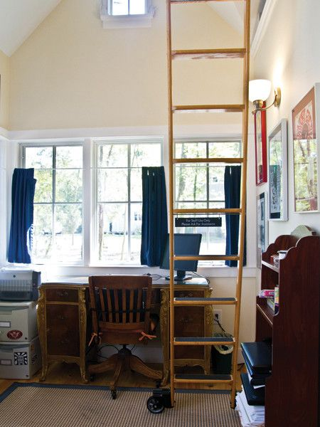 Front sitting room for the Harbinger (ladder leading to upstairs loft) | Tumbleweed Tiny House Company
