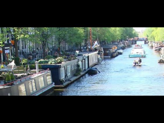 http://openarchitecturenetwork.org/files/imagecache/oanproject_slideshow_600x450/active/4/residential-houseboats-amsterdam.jpg