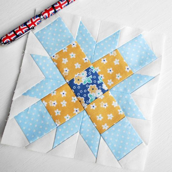 Farmer's Wife 1930s quilt block no. 47 - Joy.  Paper-pieced in bright yellow and blue.