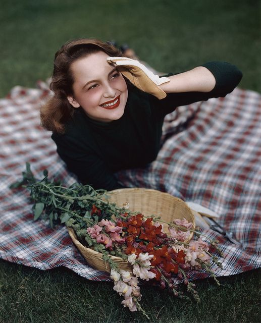 Olivia de Havilland, wearing a pretty plaid circle skirt.: