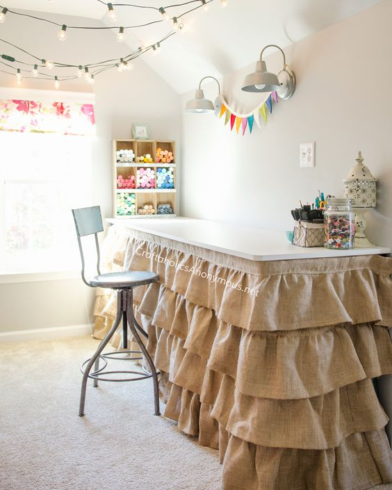 Craft Room desk with ruffled burlap skirt. Great idea to hide storage underneath the desk. Take a tour of the Dream Craft Room www.craftaholicsanonymous.net: