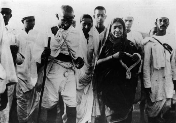 What Happened During's Gandhi's Salt March?: Indian nationalist leader Mahatma Gandhi and politician Mrs. Sarojini Naidu, with a garland, during the Salt March protesting against the government monopoly on salt production. (1930)