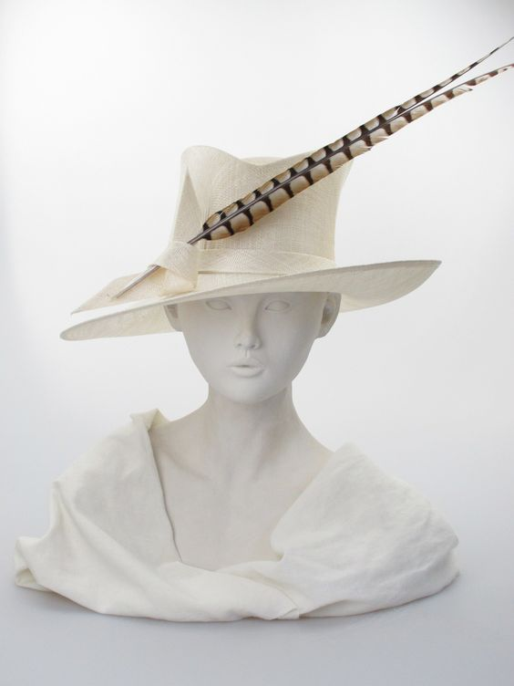 Ivory straw 'trilby crown' sloping brimmed hat with pheasant feather. Summer wear | Label: Philip Treacy | Made in England