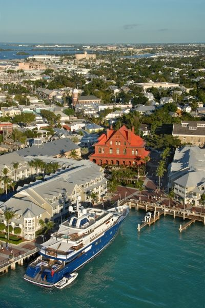 """Key West is unlike any place you've ever been. Sunsets are celebrated, roosters roam the streets, conch fritters are a recognized food group, drinking is an Olympic sport and everyone - and I do mean everyone - has a story. As one Key West resident told me, """"This is where the weird go pro."""