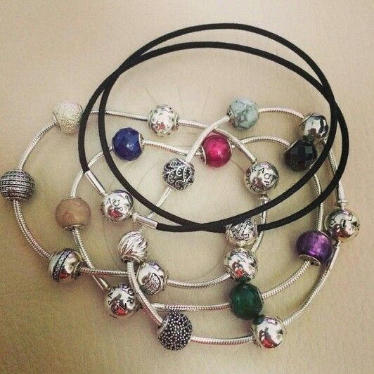 3 silver pandora essence bracelets and 1 leather bracelet