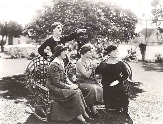 """The caption for this photo from the Alabama Department of Archives and History, written in 1918, says: """"In California to act in a silent film, Miss Keller (seated, center) met movie funny-man Charlie Chaplin in 1918. With them are (left) Miss Polly Thomson, Miss Keller's current companion and Anne Sullivan Macy, her first teacher."""":"""