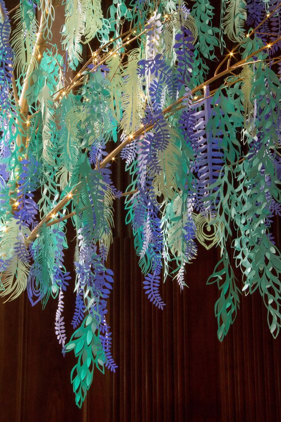 A Longwood Garden Christmas with Malinda Swain! Malinda and the team attached the cut paper to the branches using hot glue and wire to create movement and a floating effect.Photo by Duane Erdmann.