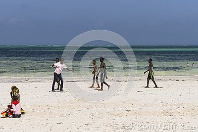 People And Resort Hotel With Restaurant At Michanwi Pingwe Beach In Zanzibar Tanzania Africa Time Of Low Tide