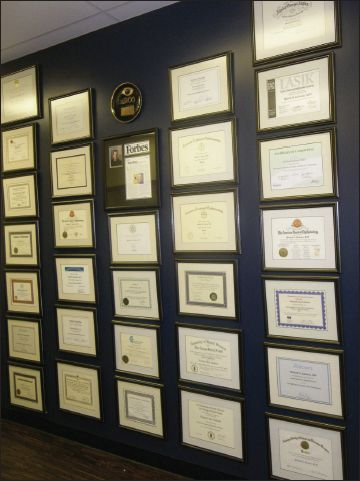 """First Impressions — How to Set the Stage for Success.  Waiting room """"bragging wall"""" of diplomas"""