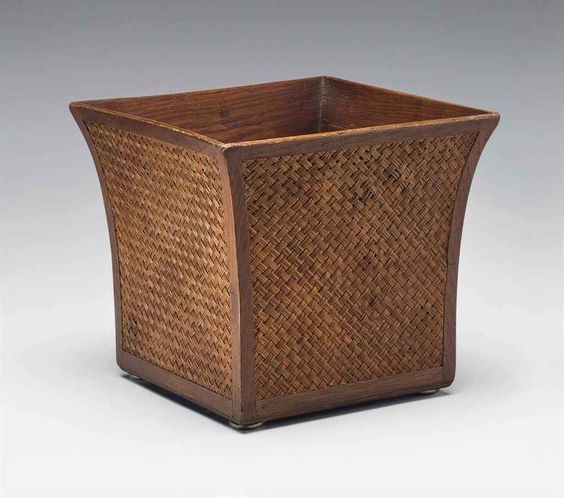 JEAN-MICHEL FRANK (1895-1941) A WASTE BASKET, 1939 oak, with cane braiding 10 1/8 in. (26 cm.) high, 11 in. (28 cm.) square