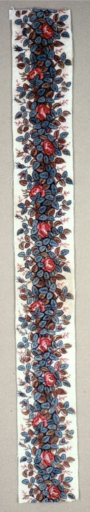 Border Oberkampf * 1750–1800  cotton - plain weave foundation. block-printed; 2 reds, blue, mustard and black. Stems with roses and leaves in fron of a black column.