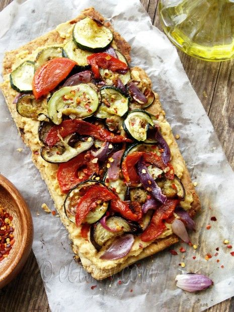Grilled Vegetable Hummus Tart- toppings: hummus, grilled veggies (onion, zucchini, eggplant, tomatoes, garlic), olive oil, crushed red pepper, sea salt, olive oil. crust: flour, olive oil, club soda, salt, pepper, dried herbs, sundried tomatoes
