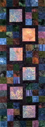 The pale batiks are so LUMINOUS against the dark background colors. From Mountainpeek Creations