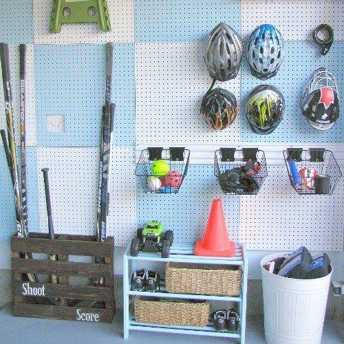 Una manera fácil de organizar su garaje = cubriendo una pared con tableros de clavijas. | 37 Clever Ways To Keep Your Whole Family Organized