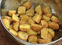 Potatoes, Tossed With Oil and Thyme  -----  Large Photo of the Roasted New Potatoes
