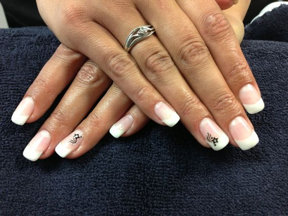 Krystal's nails. Simple French with sticker accent.  Gel nail art.
